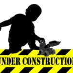 under construction sign,boy playing with bulldozer toy - vector